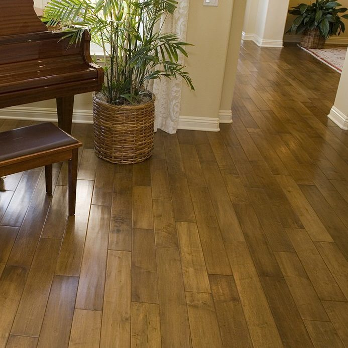Luxury home with a grand piano and a hardwood floor. ** Note: Slight graininess, best at smaller sizes
